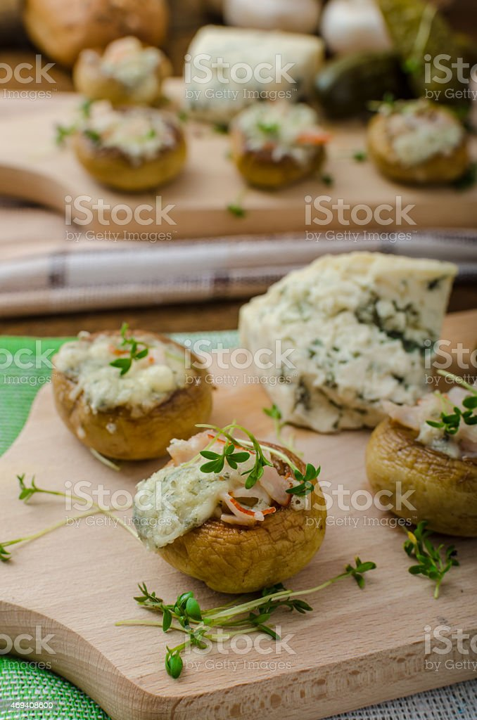 Mushrooms stuffed with cheese stock photo