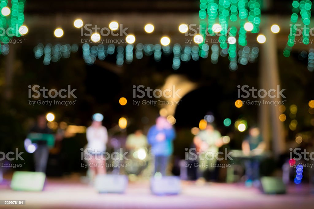 Music band  and bokeh nightlight in outdoor stage. stock photo