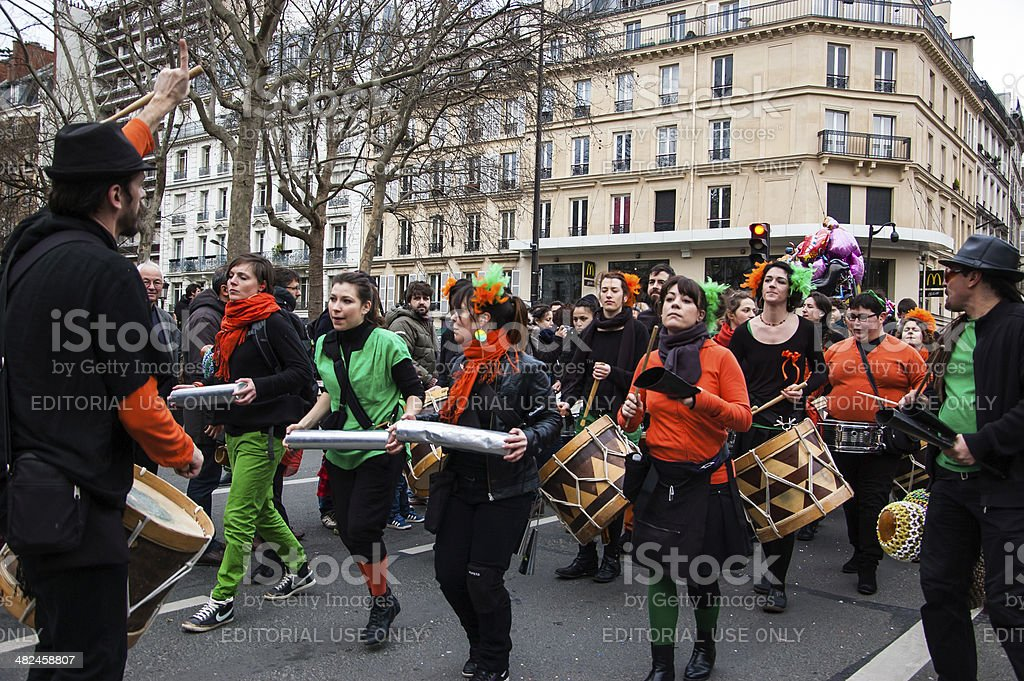 Music band in  green orange costume at Carnival of Paris. stock photo