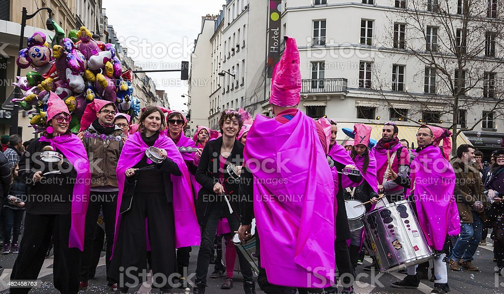 Music band in pink costumes at Carnival of Paris. stock photo