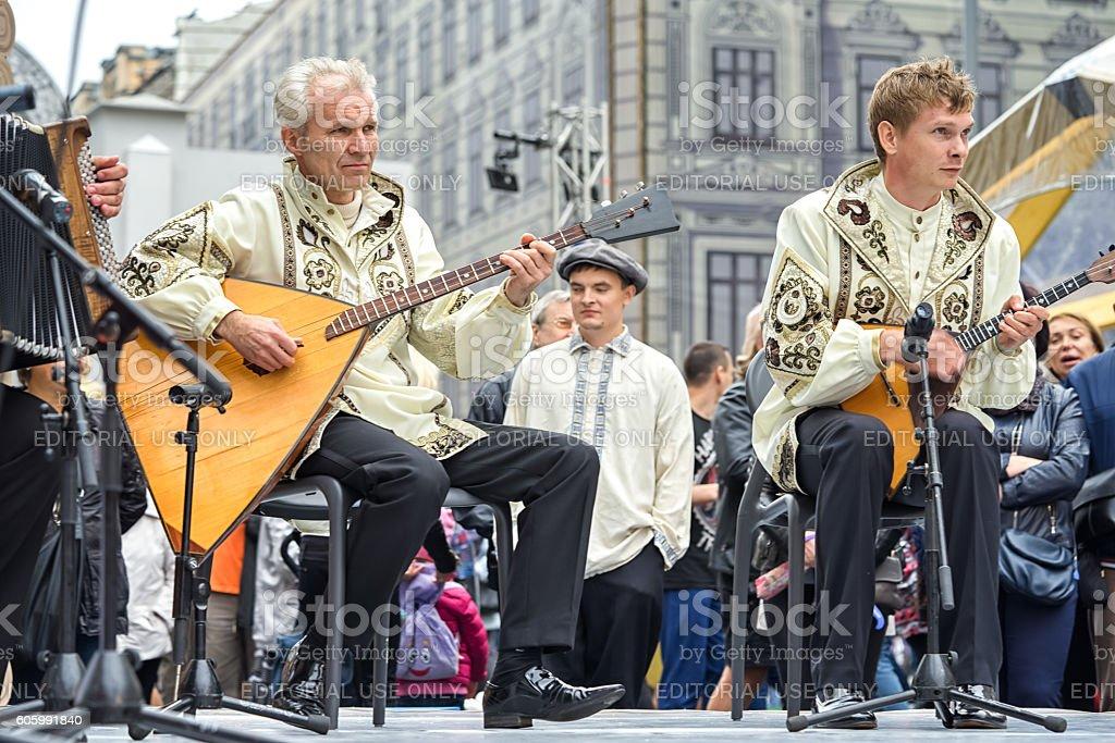 Music band performs play balalaikas. stock photo
