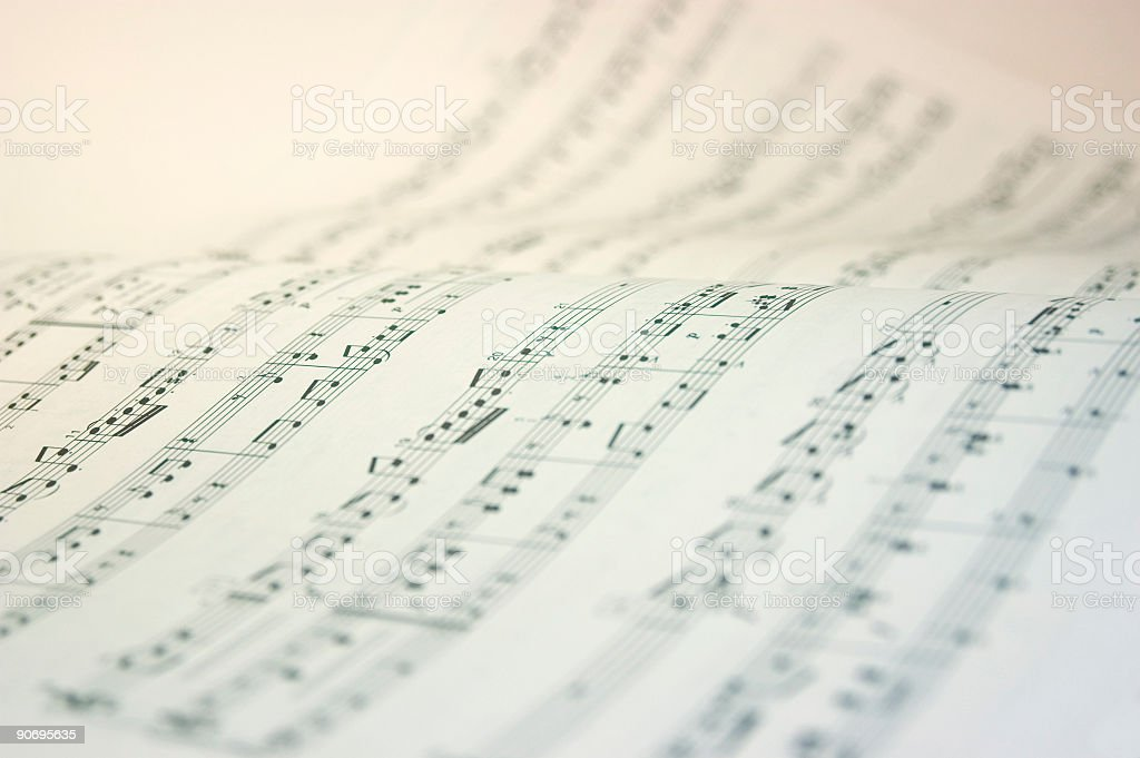 A music book open with music notes in black and white stock photo