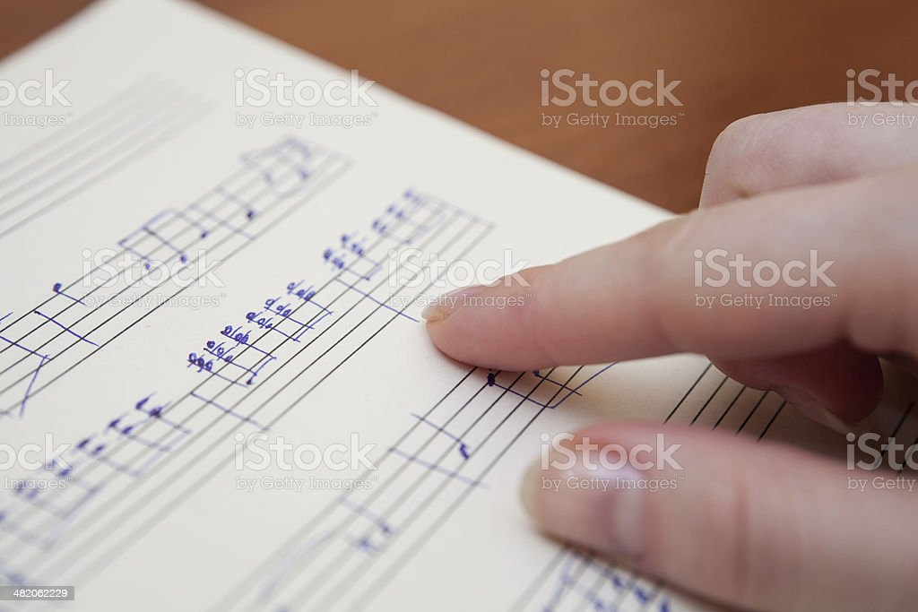 Music book with handwritten notes royalty-free stock photo