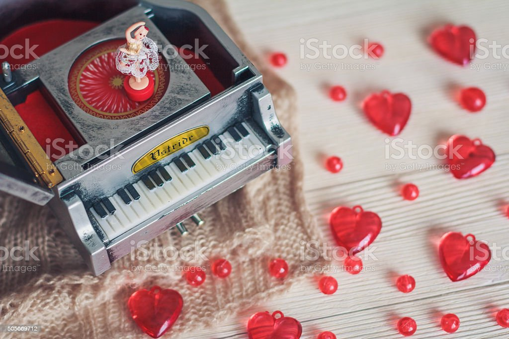 Music box with little ballerina with red hearts stock photo