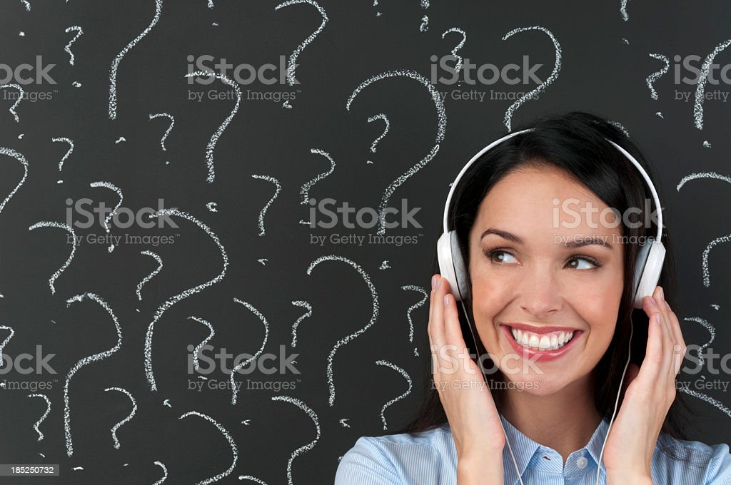 Music choice concept. Listening with question marks royalty-free stock photo