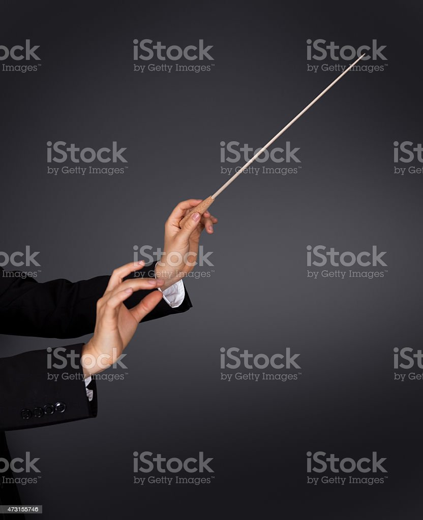 Music conductor with a baton stock photo