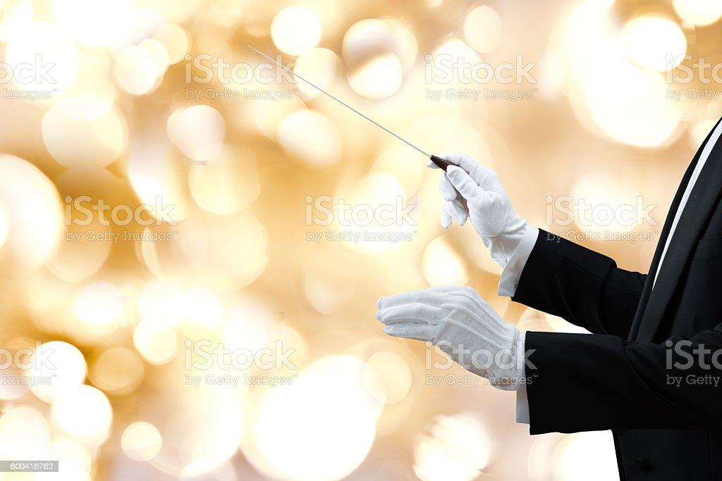 Music Conductor's Hand Holding Baton stock photo