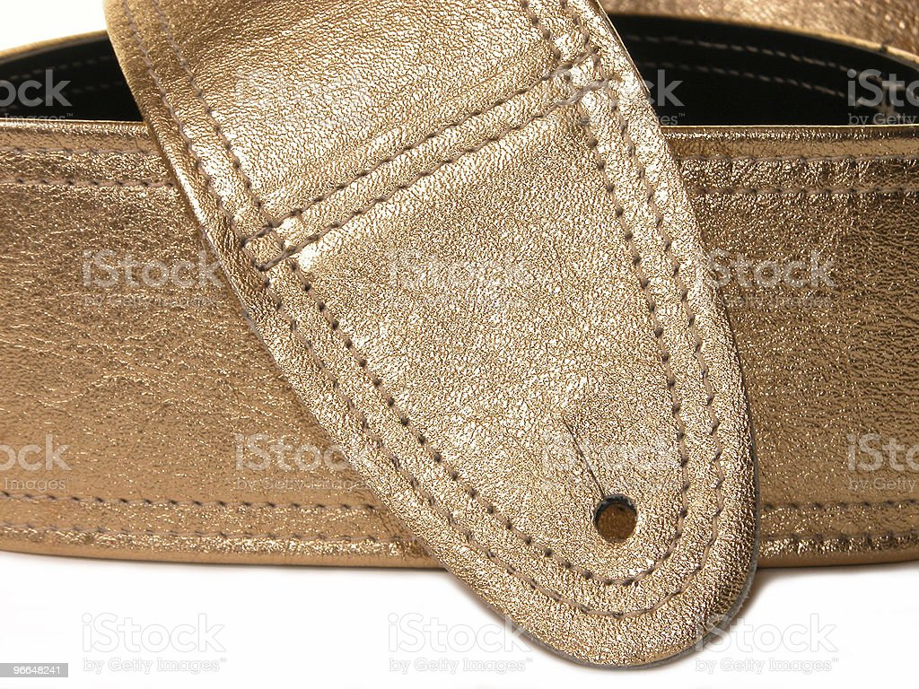 Music: Gold Foil Bonded Leather Guitar Strap royalty-free stock photo