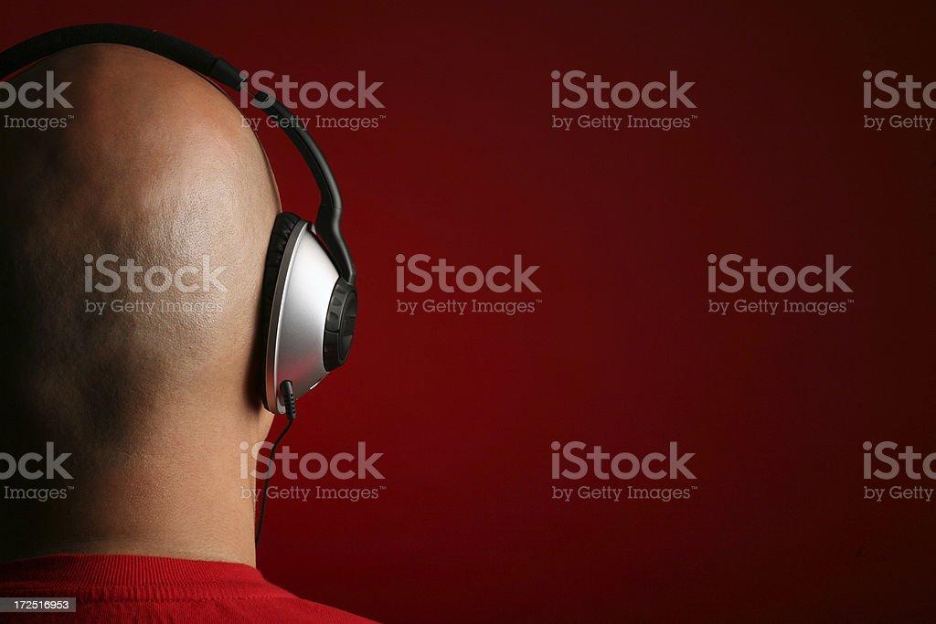 DJ Music Head with Headphones playing MP3 royalty-free stock photo