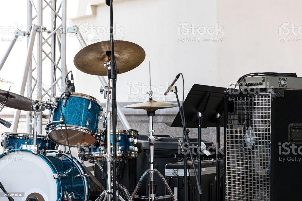 music installation with drums standing outdoors before concert stock photo
