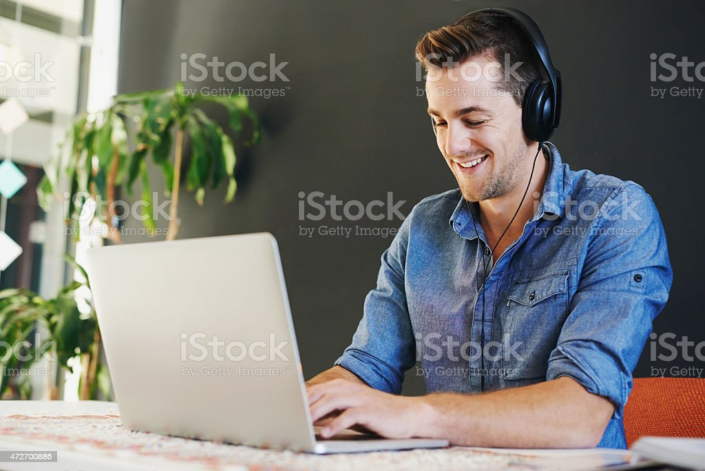 Music keeps him focused stock photo