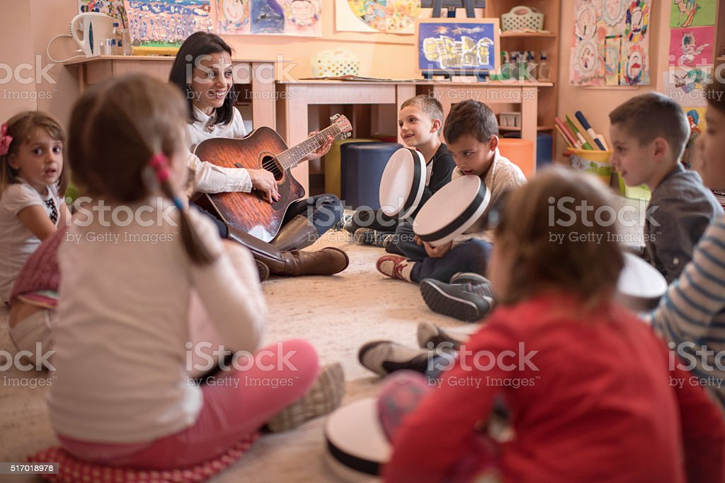 Music lesson in a kindergarten! stock photo