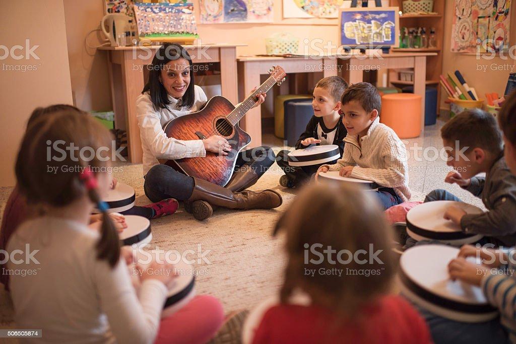 Music lesson in a preschool! stock photo