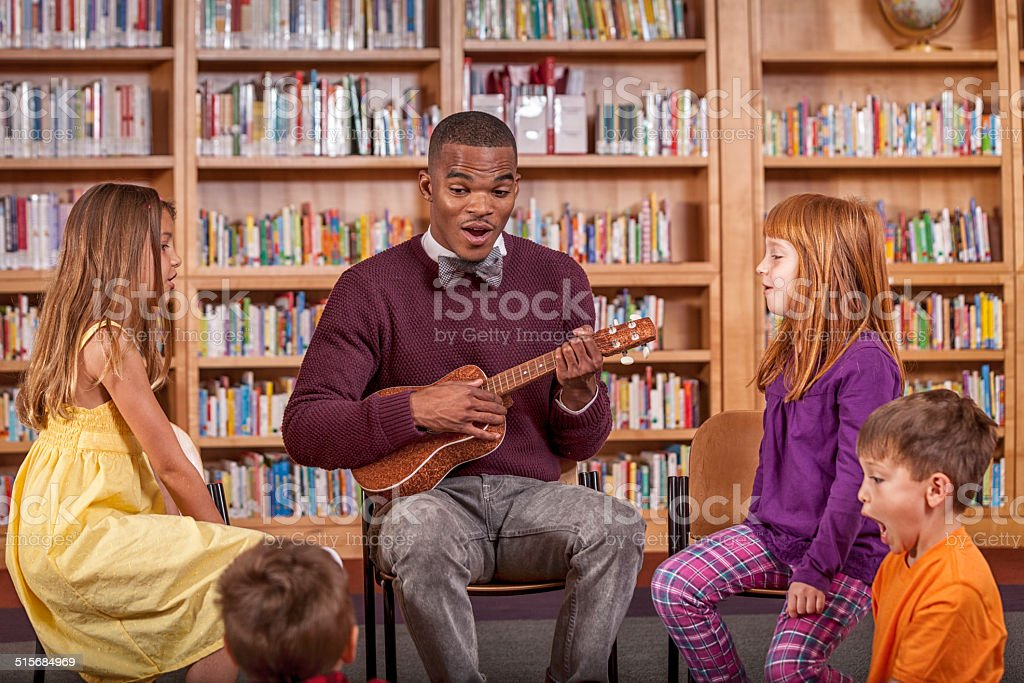 Music Lesson in the Library stock photo