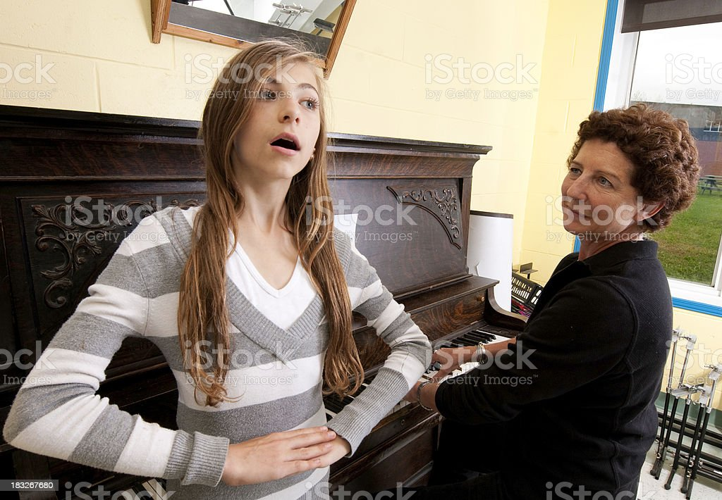 Music Lesson: Singing at the Piano royalty-free stock photo