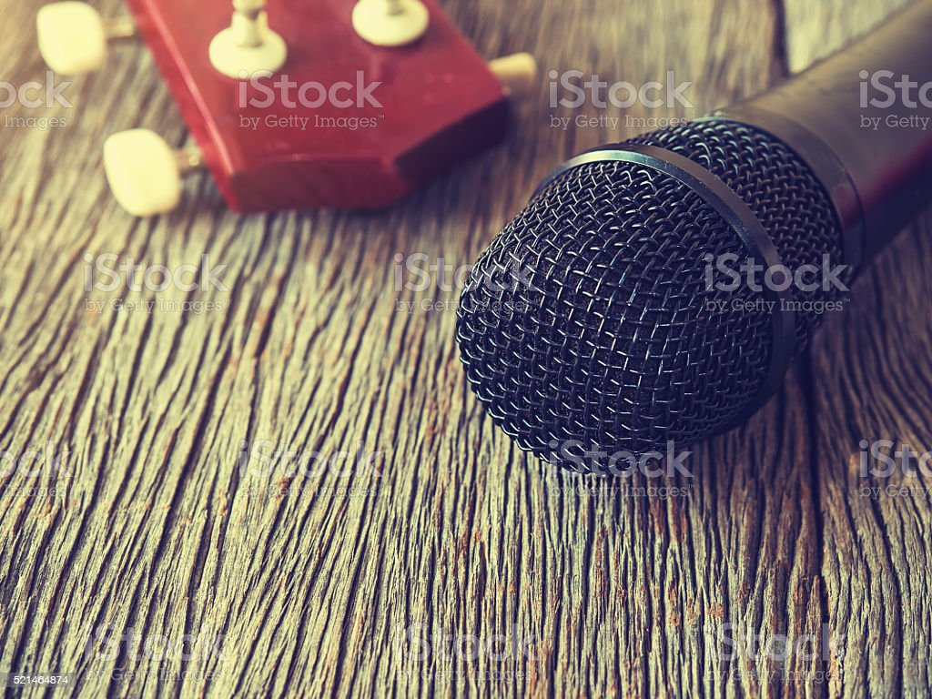 Music lover concept. A Black microphone on wooden plate. stock photo