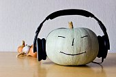 Music lover pumpkin with smile and headphones