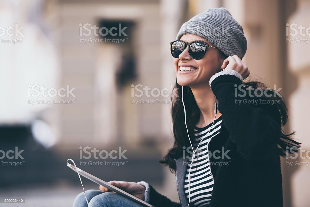 Music makes her day. stock photo