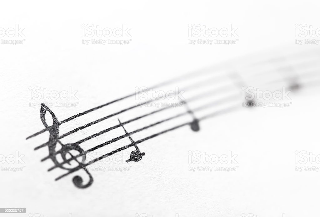 Music notes on paper. Fragment of the C major gamut. stock photo