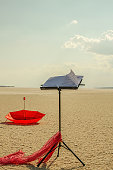 Music notes stand on the nature, sky, red umbrella