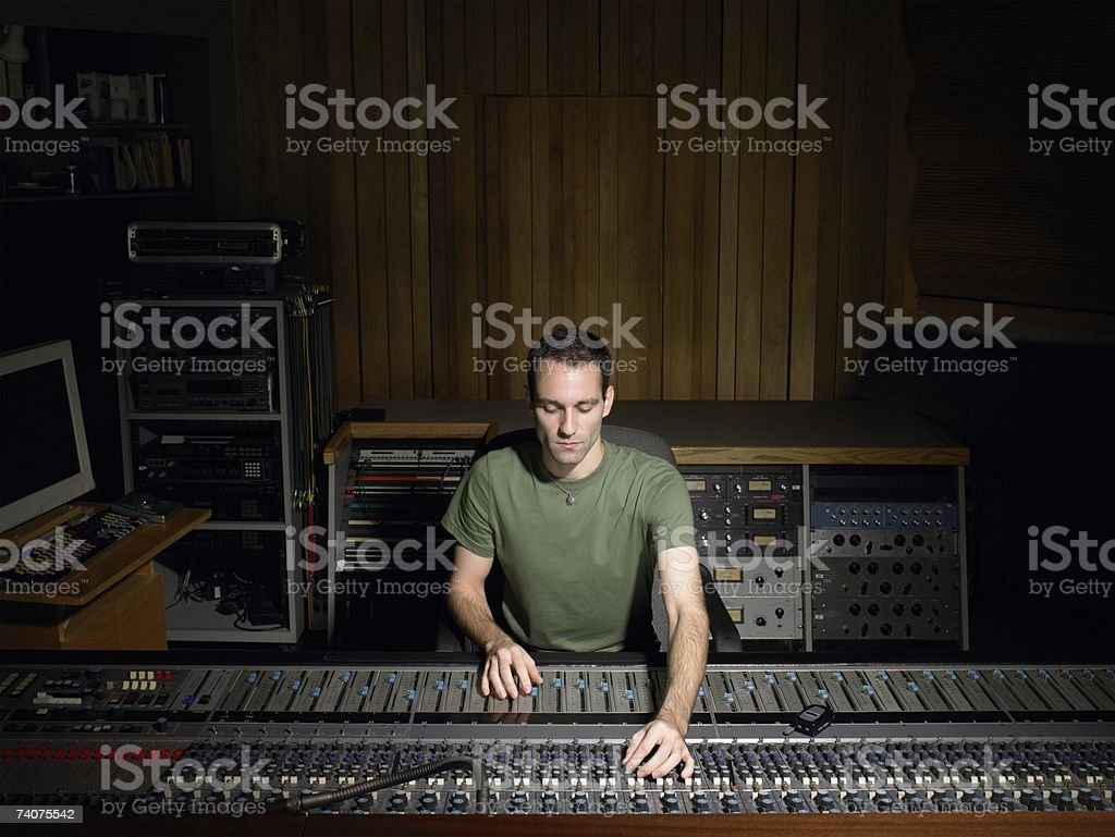 Music producer using mixing desk stock photo
