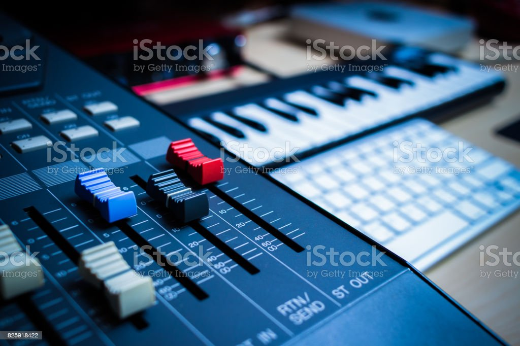 music production concept. sound mixer, midi keys, audio interface & computer keyboard stock photo