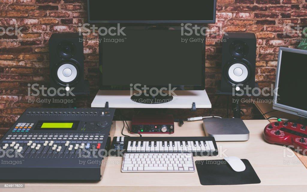 music production equipment in digital recording studio stock photo