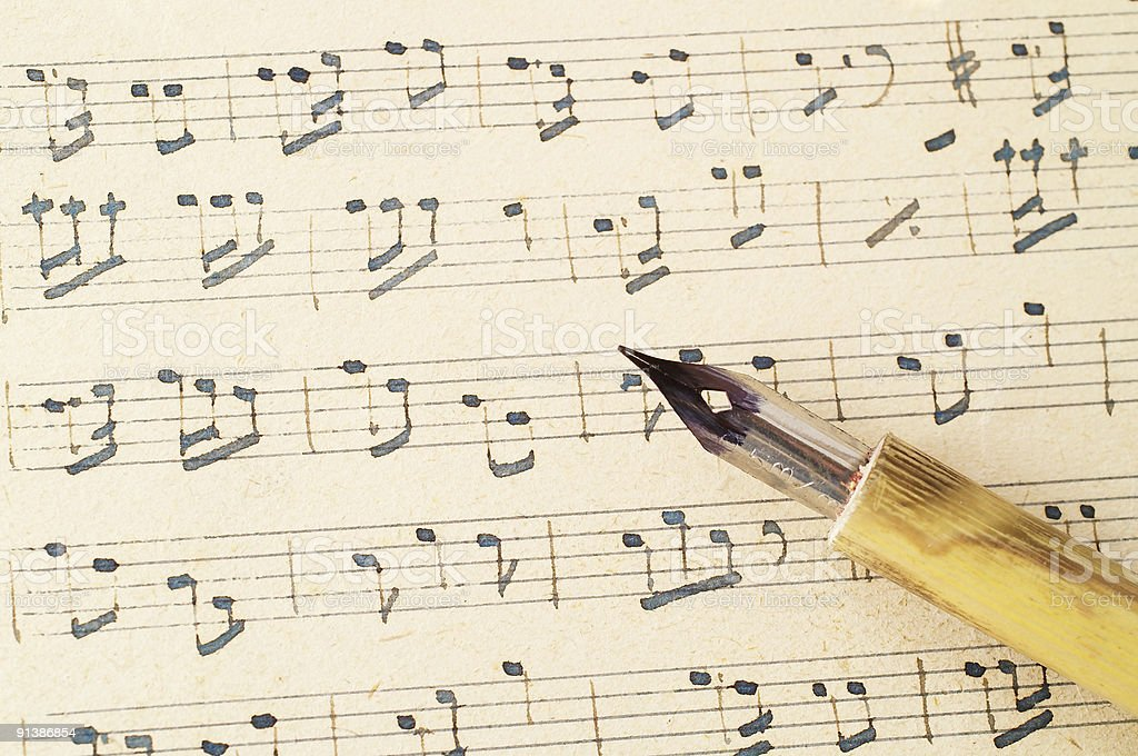 Music score and old pen. royalty-free stock photo
