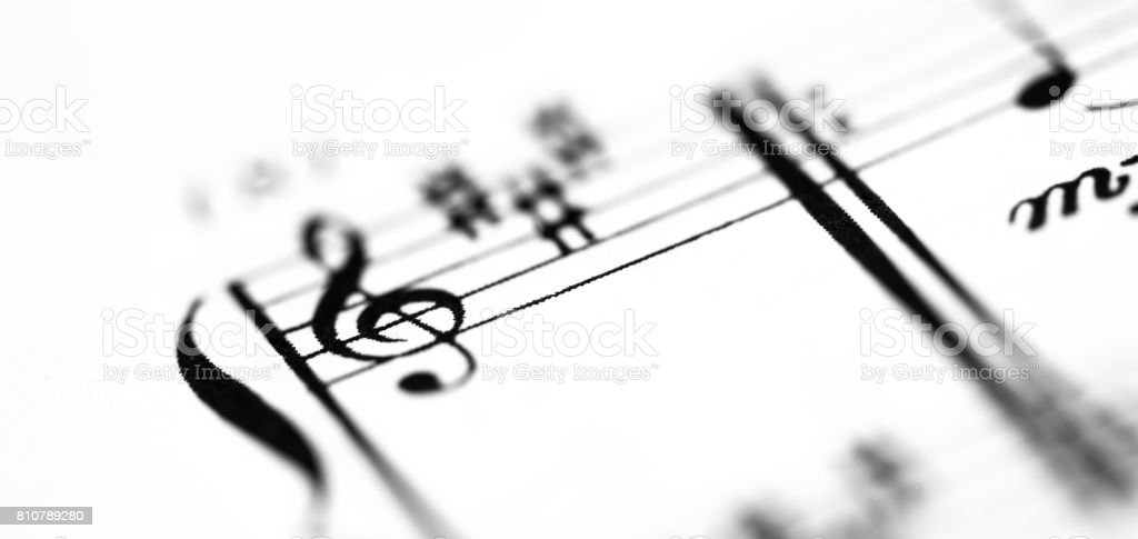 A music score sheet with the focus on the G-clef stock photo
