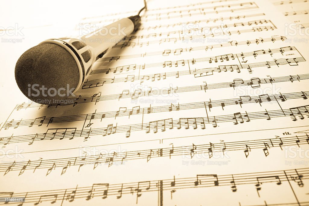 Music sheet and microphone royalty-free stock photo