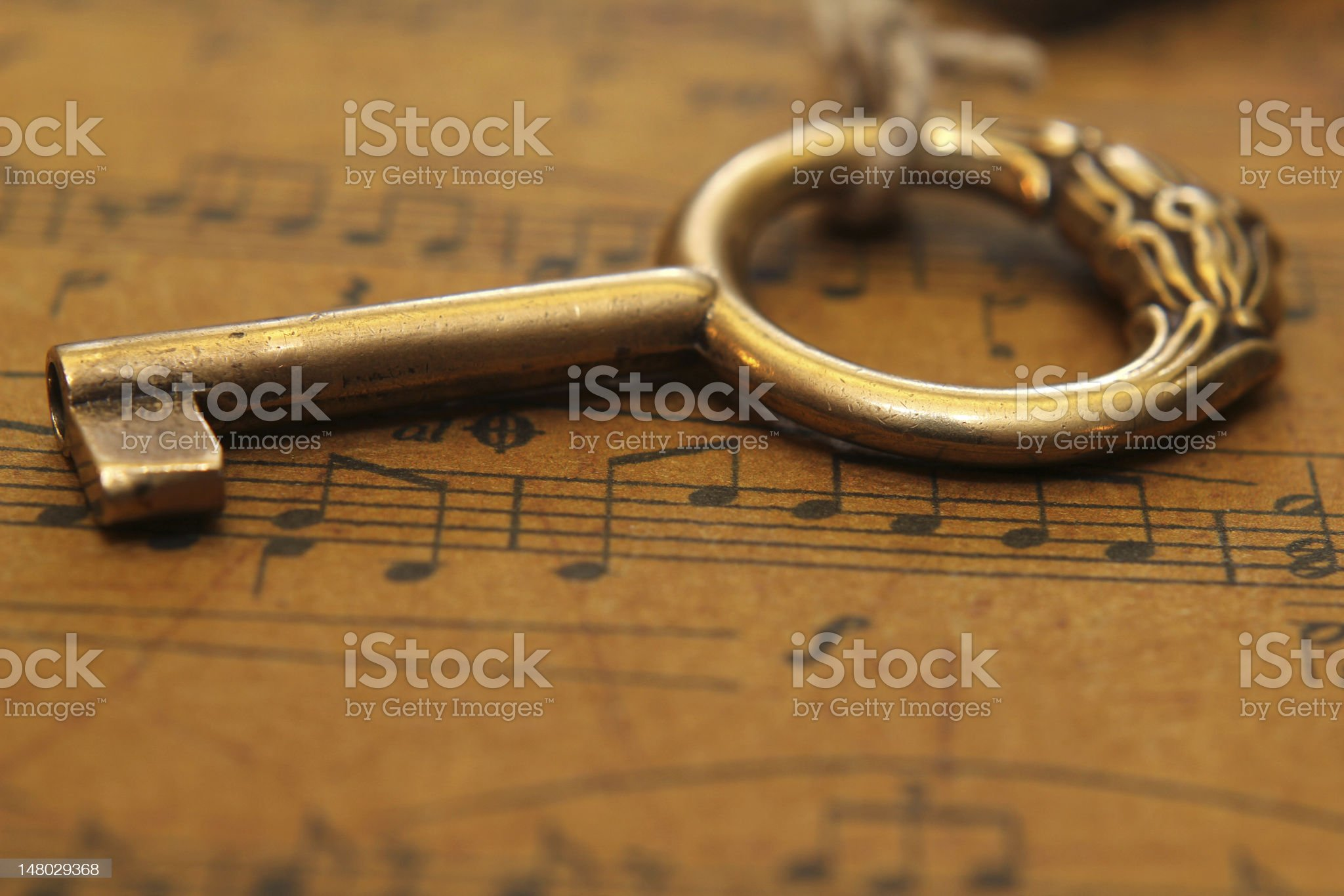 Music sheet and old key royalty-free stock photo
