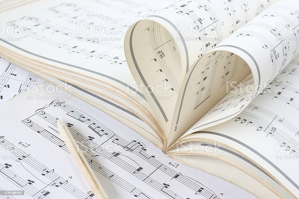 music sheet curve look like heart stock photo