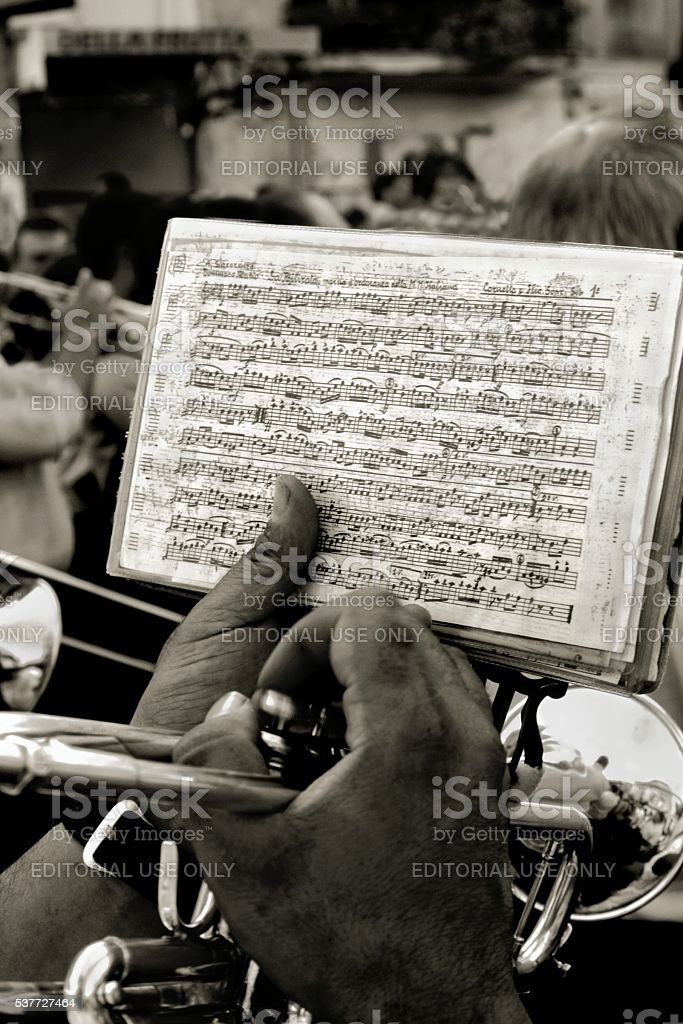 Music sheet hands of bugler marching band stock photo