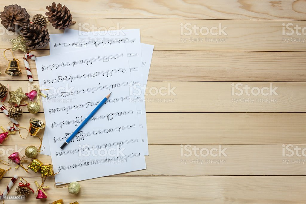 music sheet note paper and christmas decoration on wood. stock photo