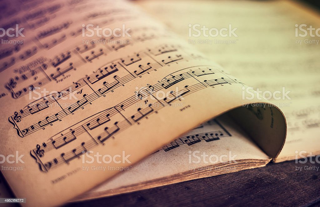 Music sheets on wooden background stock photo