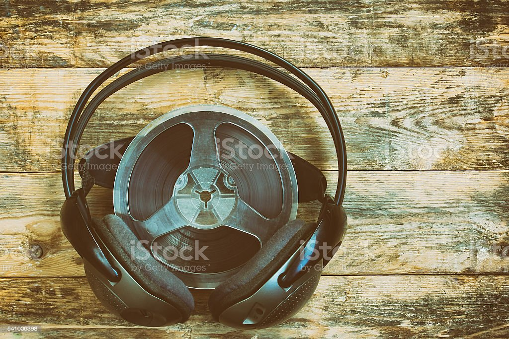 Music spool tapes and headphones stock photo
