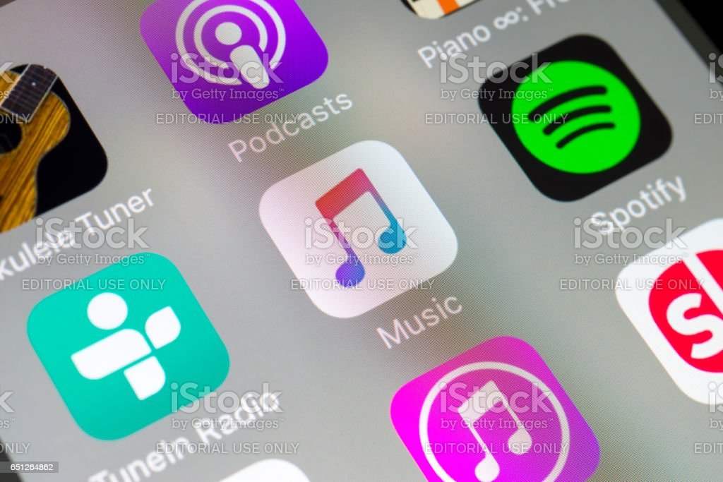 Music, Spotify and other audio apps on cellphone stock photo