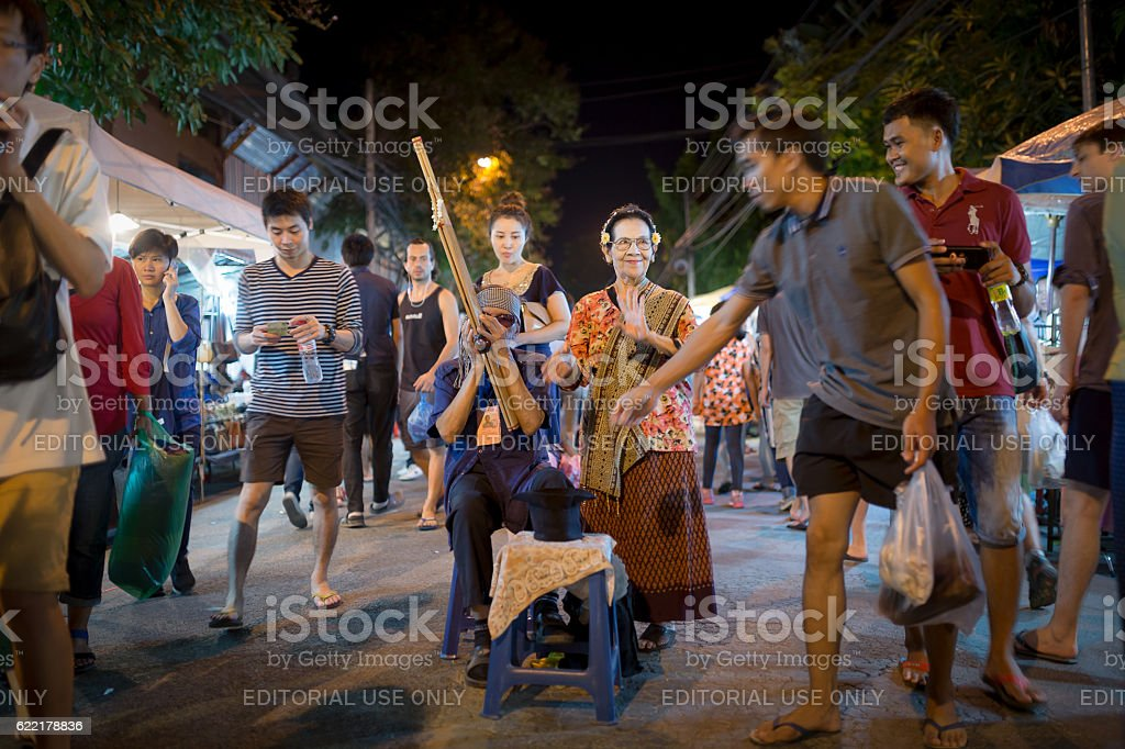 Music street performer are sing a song. stock photo