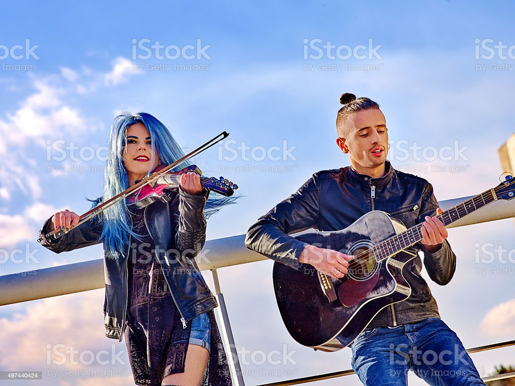 Music street performers with girl violinist stock photo