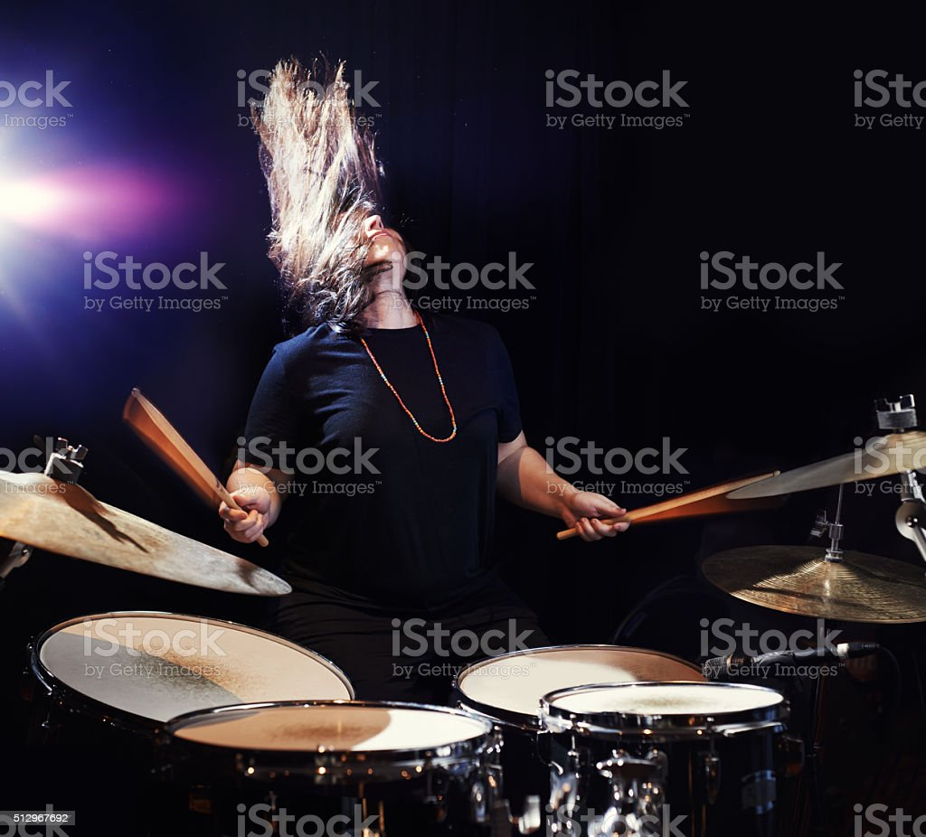 Music to bang her head to! stock photo