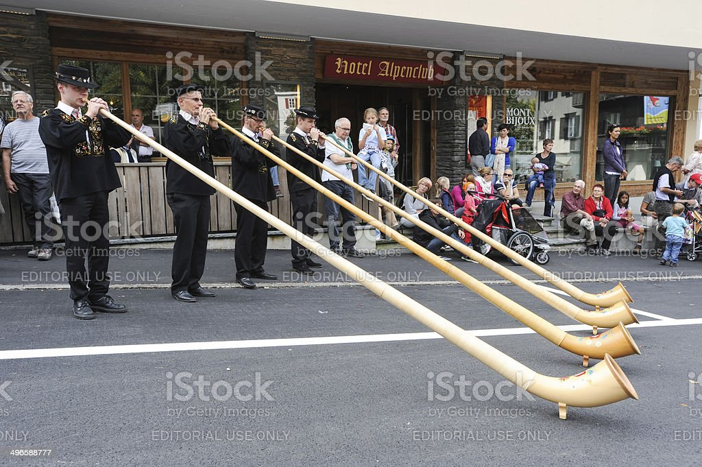 Music with alphorn at Engelberg on the Swiss alps stock photo