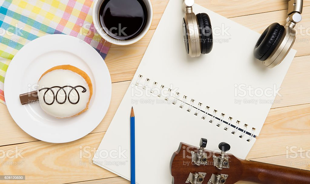 Music writing equipment on a sweet cafe table stock photo