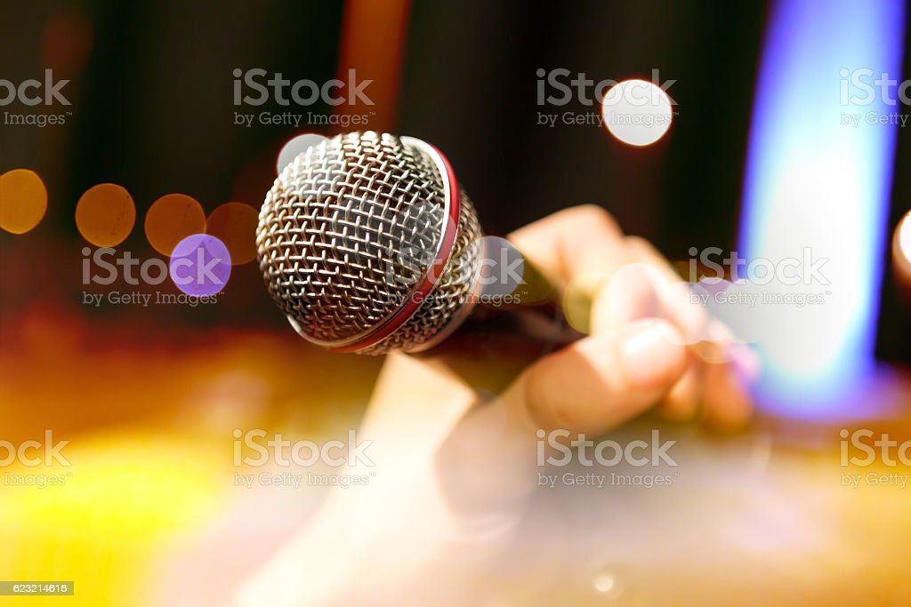 Musical background.Mic and singer stock photo