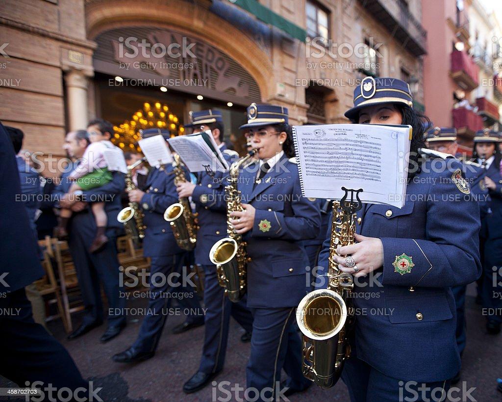 musical band playing during semana santa in sevilla royalty-free stock photo