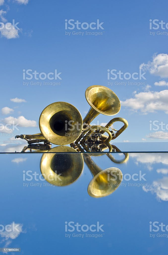musical brass wind instruments on mirror stock photo