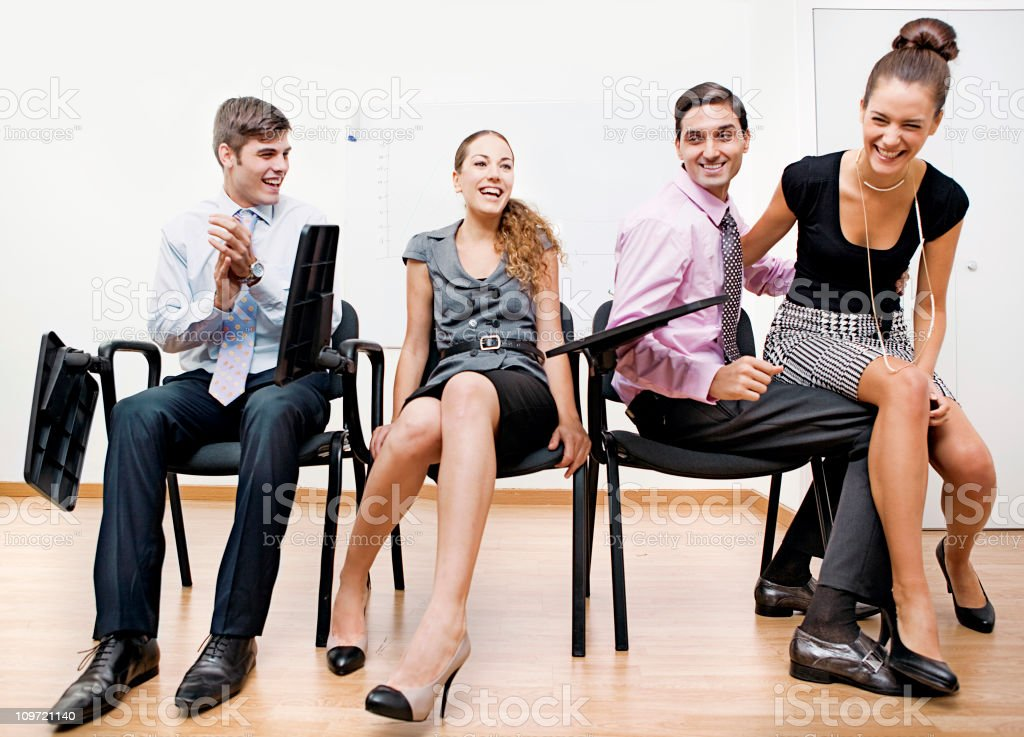 Musical chairs Game at the office stock photo