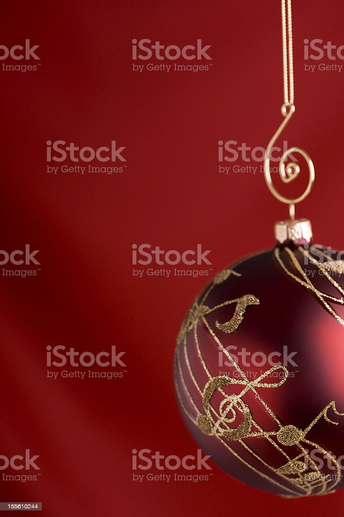 Musical Christmas Bauble on Red stock photo