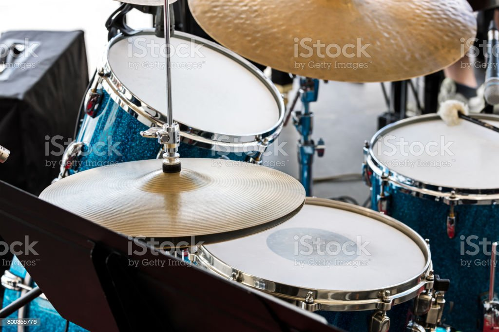 musical equipment on stage. drum set ready for street performance. stock photo