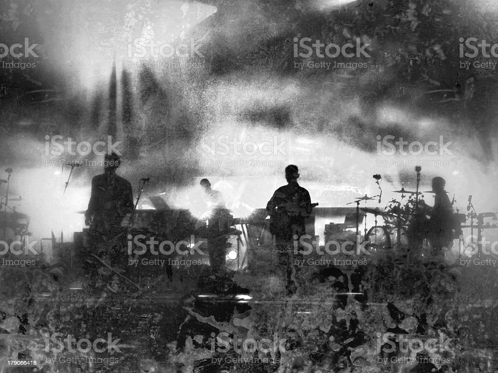 musical group performing on stage at a concert stock photo