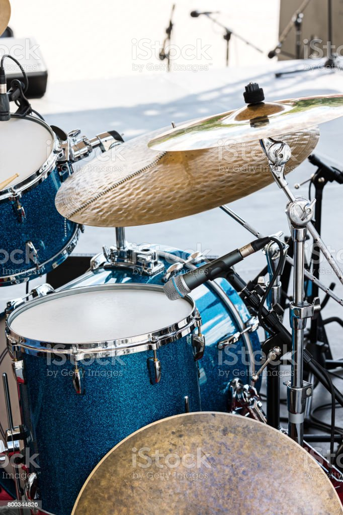 musical installation of drums, cymbals and microphones ready for performance stock photo